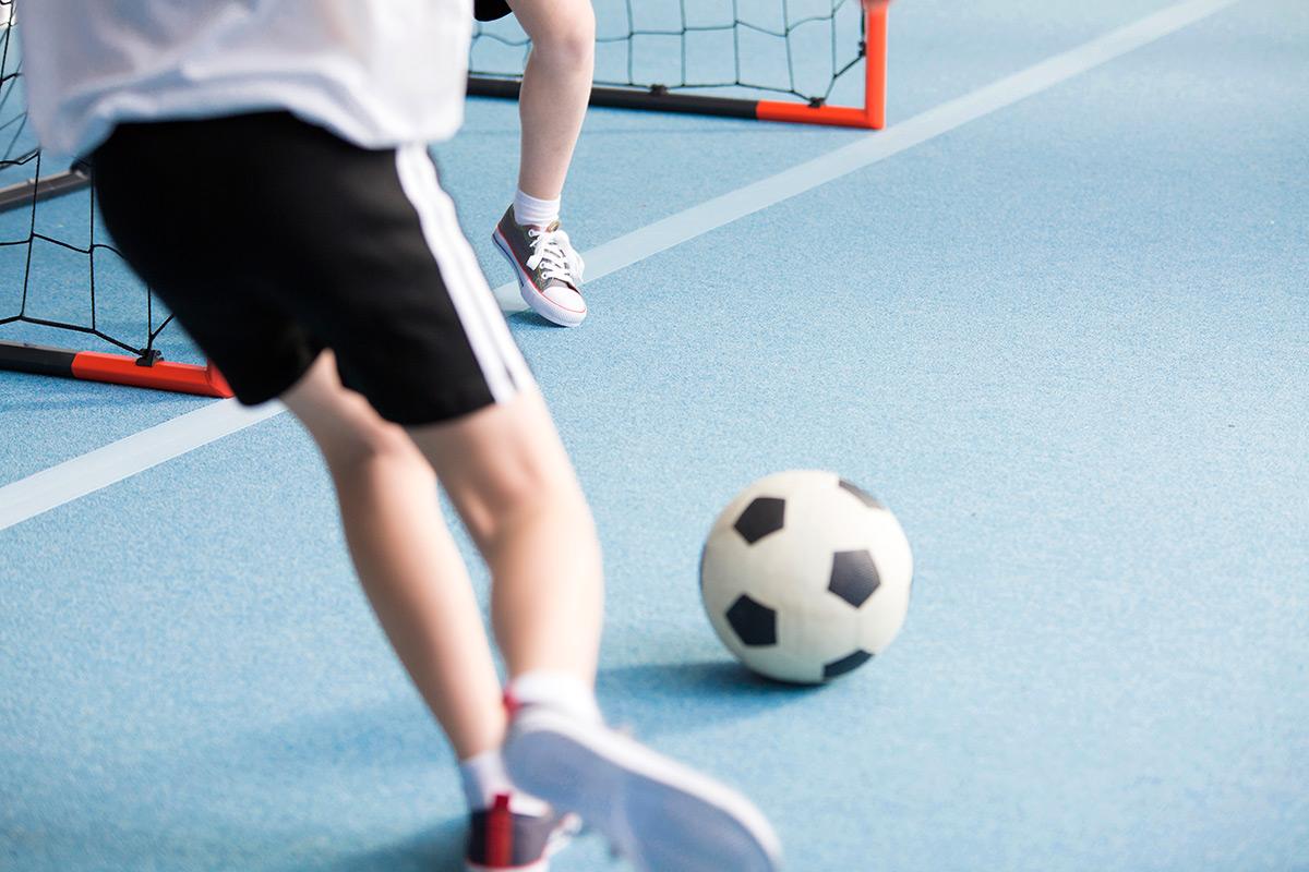 boy-playing-soccer-PKFGTZH