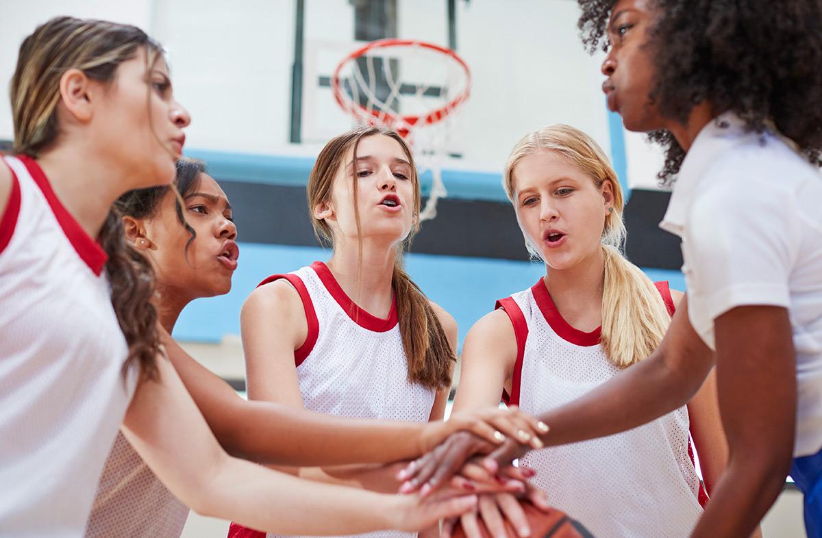 female-high-school-basketball-players-joining-VE7YBHT